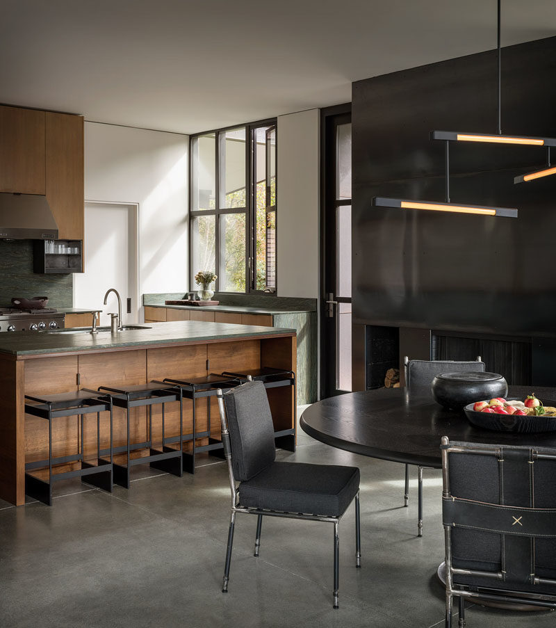 Kitchen Ideas - This modern kitchen features green soapstone countertops and oak veneer cabinets. #KitchenIdeas #ModernKitchen #KitchenDesign