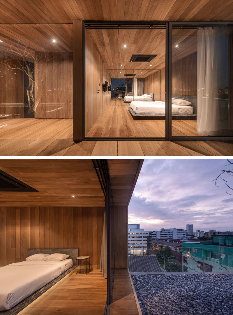 Bedroom Ideas - This modern bedroom has a sliding sliding glass door that opens up to the outdoor space. #WoodBedroom #ModernBedroom #BedroomIdeas