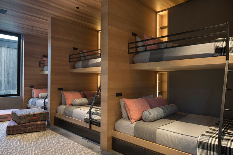 Bunk Bed Ideas - This modern and large bedroom has been designed with custom bunk beds, allowing the room to sleep at least six people, if not more. #BunkBeds #BunkBedIdeas #ModernBunks