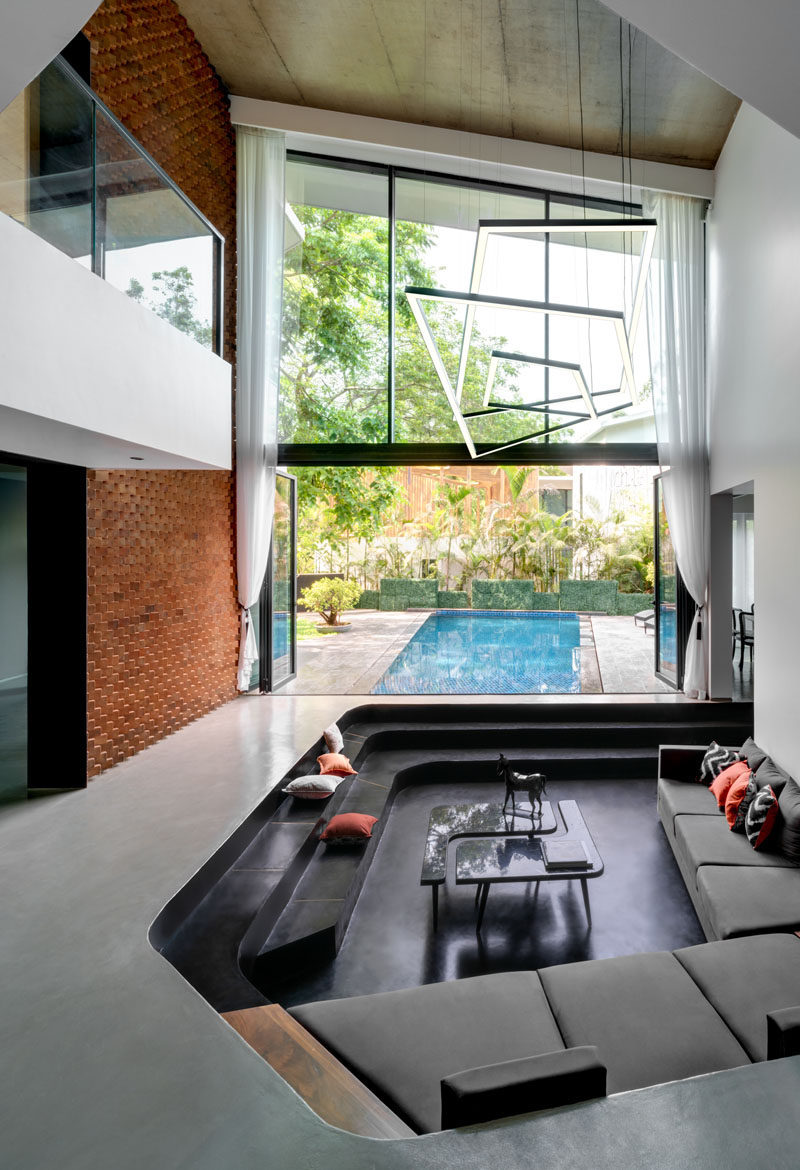 Design Detail - A Sunken Living Room Sits By The Pool At This New House