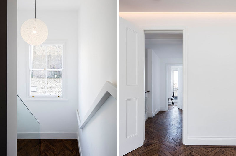 White and wood stairs lead up to the master bedroom and a home office. Hidden lighting helps to create a soft glow on the ceiling. #Stairs #Lighting #WoodFlooring