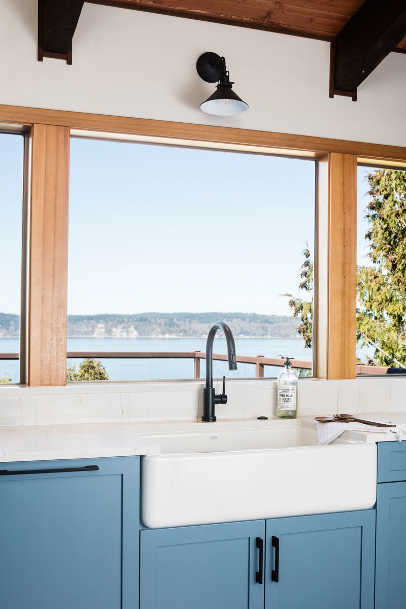 Kitchen Ideas - The designers of this modern light blue kitchen, used LED strip lighting, small flush mounts, and wall sconces, to create a welcoming space. #KitchenIdeas #BlueCabinets #LightBlueKitchen #KitchenDesign #Lighting