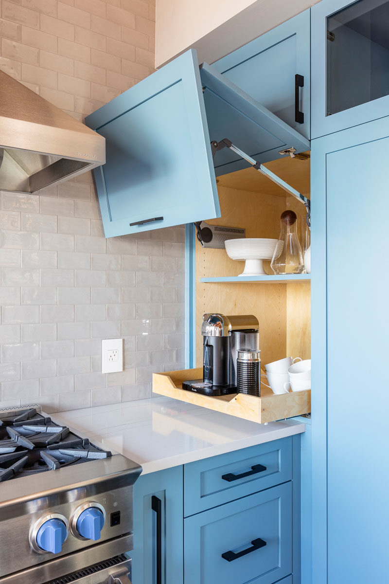Kitchen Ideas - This modern kitchen with its matte light blue cabinets, has a cupboard with a lift up door, that's dedicated to a coffee station. #KitchenIdeas #BlueKitchen #KitchenDesign #ApplianceGarage #CoffeeStation