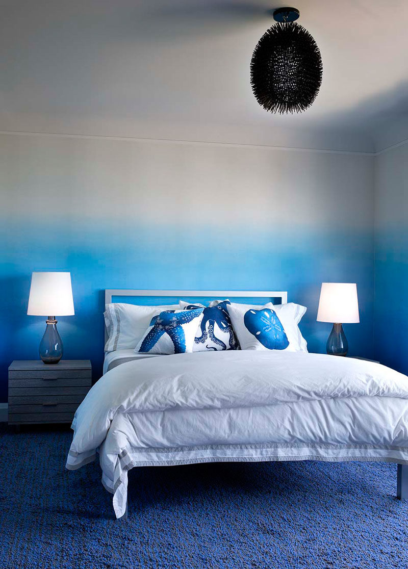 Bedroom Ideas - In this modern bedroom, an ombre accent starts with the bold blue carpet, travels up the wall, and transitions into a soft lavender ceiling. #Ombre #BedroomIdeas #ModernBedroom #BlueBedroom