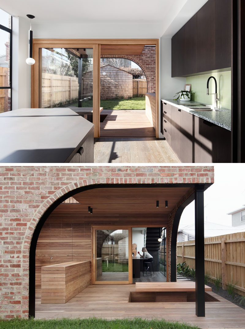 Outdoor Spaces - A large sliding wood-framed glass door opens this modern kitchen to a covered patio, that features a sunken seating area with a table. #Patio #SunkenTable #ModernOutdoorSpace