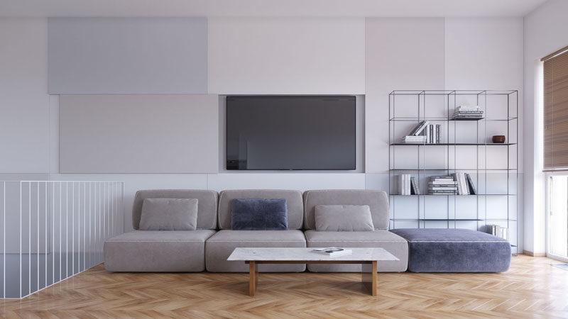 Living Room Ideas - This modern living room has decorative panels on the wall, that when one is slid open, it reveals the television. #HideTelevision #LivingRoomIdeas #InteriorDesign
