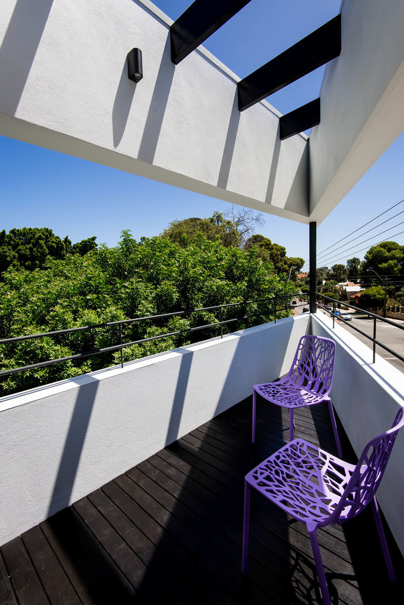 This modern balcony features a black stained timber deck with black stained beams overhead, and a custom steel detailed balustrade. #Balcony #ModernHouse #Architecture