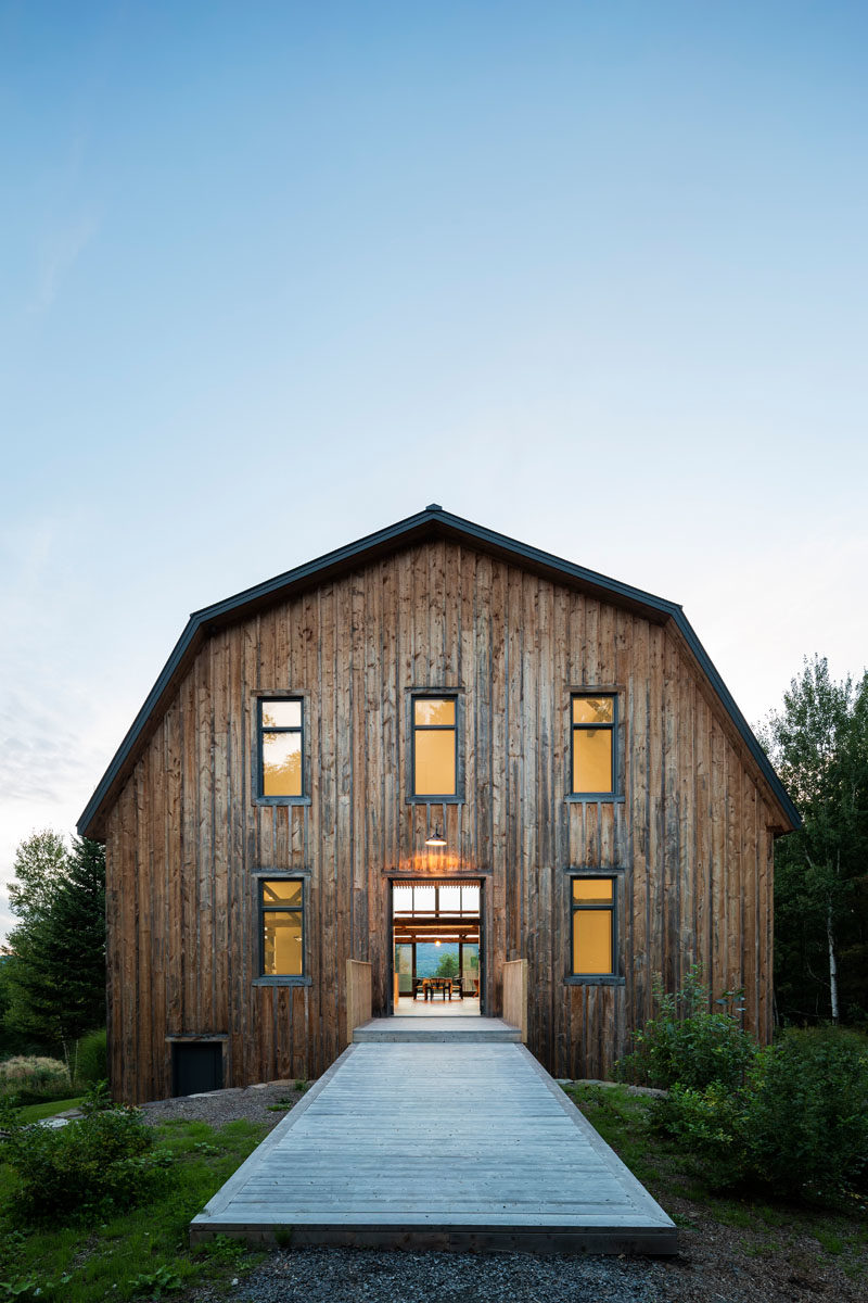 Architecture studio La Firme, have completed the modern restoration of a 100 year old barn in Quebec, Canada. #Barn #ModernBarn #Architecture