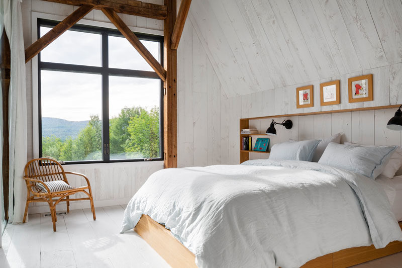 Bedroom Ideas - The bedrooms in this modern barn have whitewashed wood walls and floors, and large windows that provide treetop views. #ModernBarn #ModernBedroom #BedroomIdeas