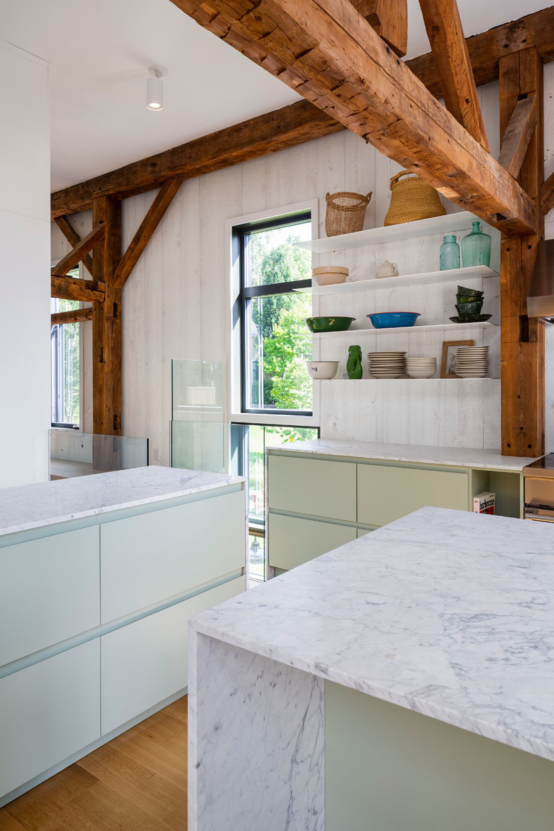 Kitchen Ideas - In this kitchen, whitewashed walls complement the thin floating shelves and light green cabinets. #KitchenDesign #KitchenIdeas #ModernKitchen #BarnKitchen