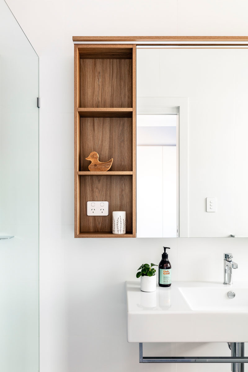 Bathroom Ideas - Open wood shelving provides additional storage and a natural element in this modern bathroom. #BathroomDesign #BathroomIdeas #ModernBathroom