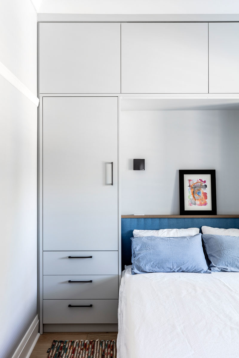 Bedroom Ideas - This modern bedroom has built-in cabinets that provides much needed storage as there isn't a separate closet in the room. #BedroomStorage #BedroomIdeas #BedroomDesign #BedroomCloset