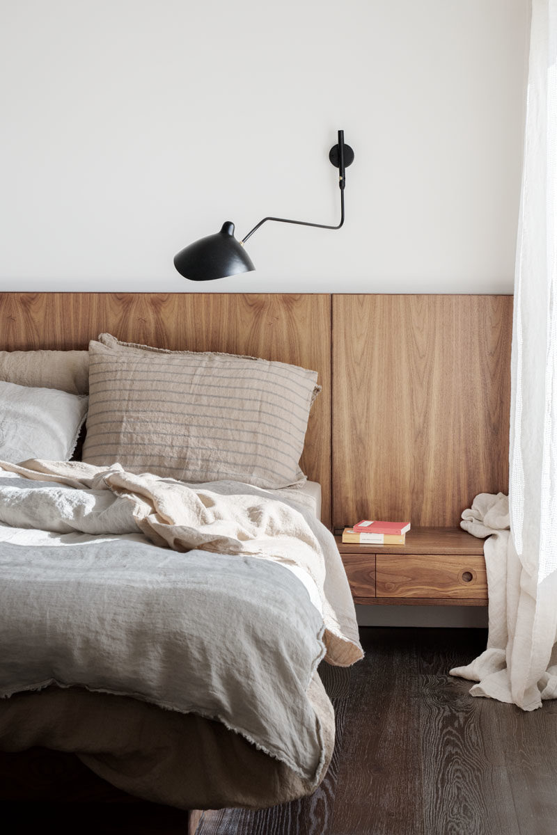 Bedroom Ideas - This modern ebdroom includes a custom designed wood headboard that includes built-in side tables. #ModernBedroom #WoodHeadboard #BedroomIdeas #MasterBedroom