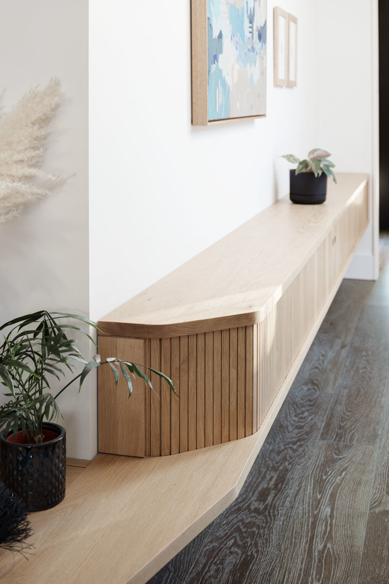Entryway Ideas - This modern house has a built-in bench by the front door that also includes storage. #Bench #Entryway #InteriorDesign