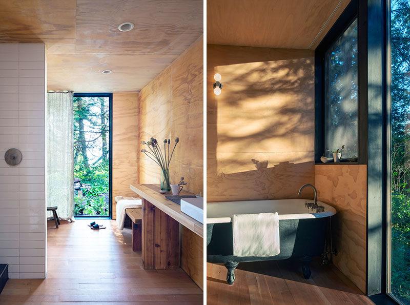 Bathroom Ideas - A reclaimed cast iron tub in the master bath creates the feeling of soaking in the outdoors. #BathroomIdeas #Cabin