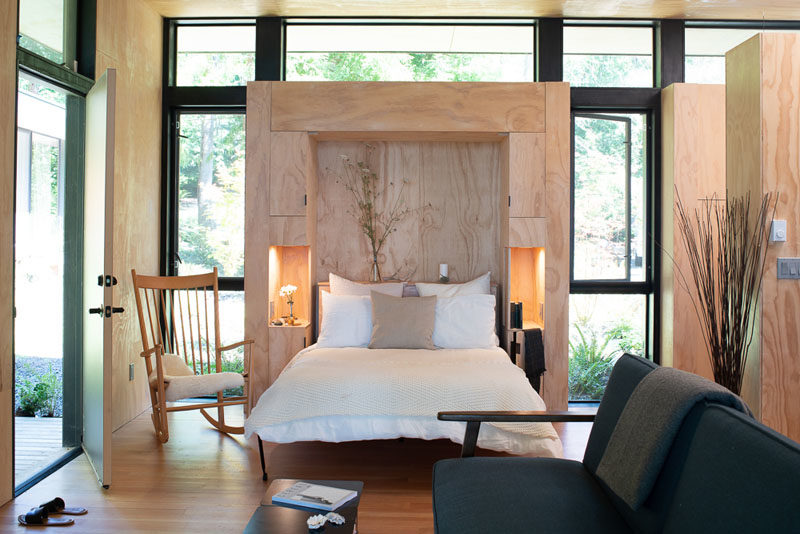 Bedroom Ideas - This built-in murphy bed in the allows the cabin to be a flexible sleeping area when needed. #MurphyBed #Cabin #ModernBedroom #Windows