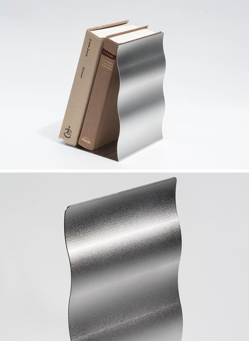 Gift Ideas - Named the 'Wave Stand', these modern bookends provide a steady support for different objects to lean on. Their design was inspired by the waves that occur in nature, with the stainless steel plate shaped to mimic the softness and the organic expression of nature. A sandblast finish has been applied to create a natural sparkling texture. #Bookends #ModernBookend #GiftIdea #ModernDecor #HomeOfficeAccessories #DeskAccessories