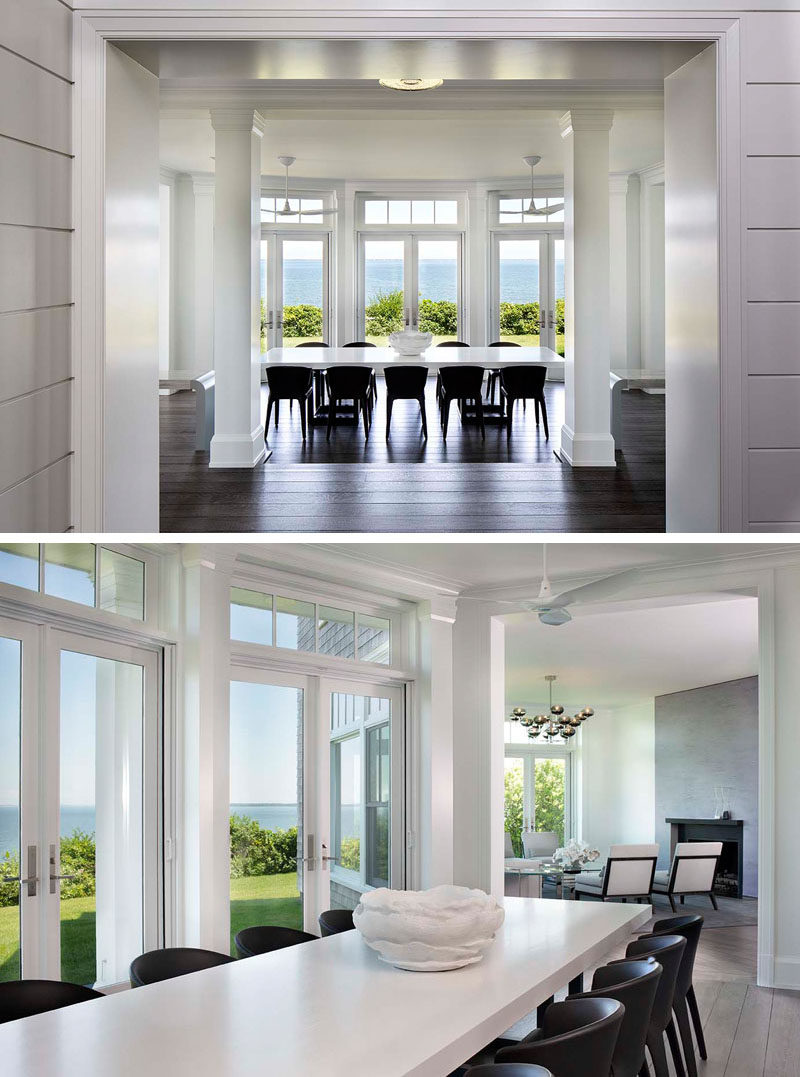 Dining Room Ideas - Inside this contemporary house, the windows in the dining room are framed with pilasters, while modern touches have been added in the form of furniture and lighting. #DIningRoomIdeas #DiningRoom