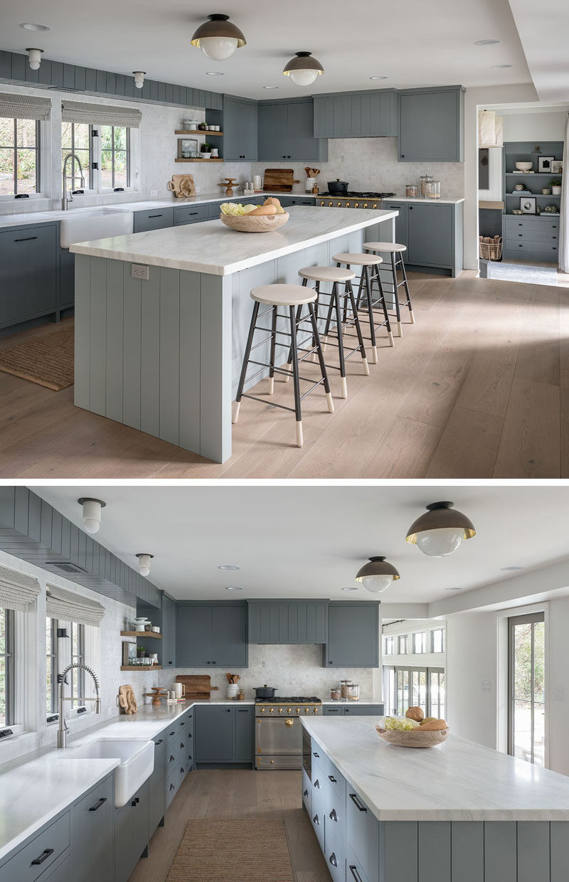 Kitchen Ideas - In this farmhouse-inspired kitchen, the color palette includes greys and white, with an apron sink adds to the farmhouse look of the home, and a large island adds room for people to sit and socialize while cooking. #KitchenDesign #KitchenIdeas #GreyAndWhiteKitchen #FarmhouseModern #ModernFarmhouse