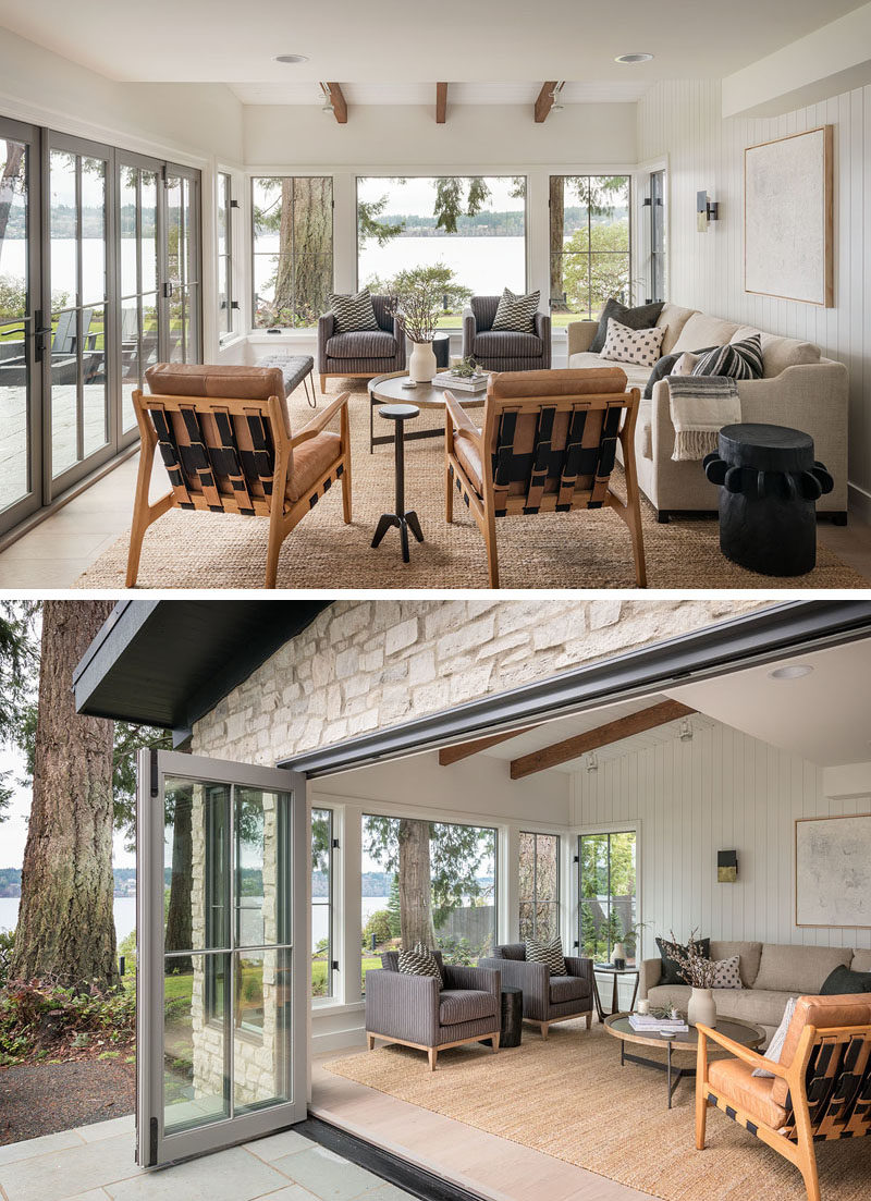 Living Room Ideas - Folding doors open this contemporary living room to the patio outside, while large windows provide uninterrupted views of the water. #LivingRoom #Windows #LivingRoomIdeas