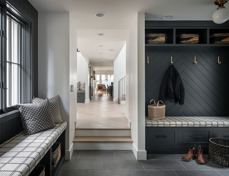 Mudroom Ideas - This modern mudroom has built-in benches, and storage nooks provide a place to keep jackets and shoes organized. #Mudroom #MudroomIdeas #ModernMudroom