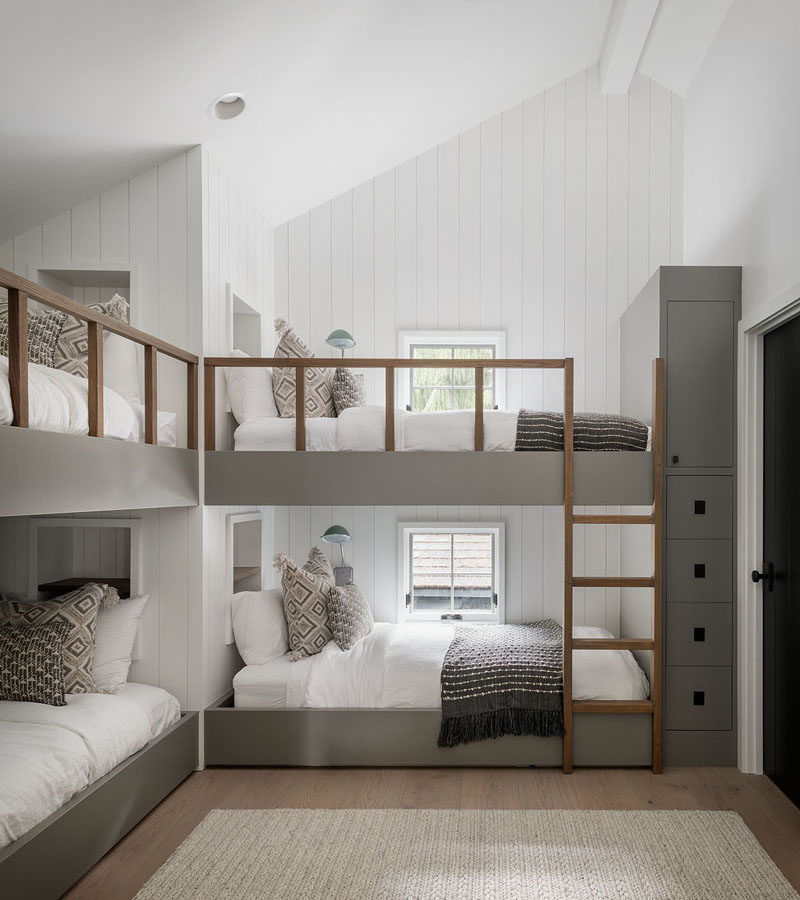 Bedroom Ideas - This modern bedroom has been furnished with custom-designed bunk beds. Each bunk bed has a built-in shelf at the head of the bed, and a minimalist wood ladder for easy access. #BedroomIdeas #BunkBeds #Bunks
