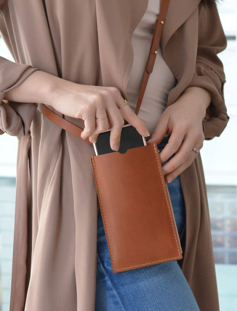 Style Ideas - This modern leather cellphone sling allows you to keep your phone close while staying completely hands free. In addition, it has a double pouch with a zipper closure, and an additional card sleeve. #Style #CellphoneSling #PhonSling #LeatherBag #MinimalistBag #ModernStyle #ModernBag #SmallHandbag