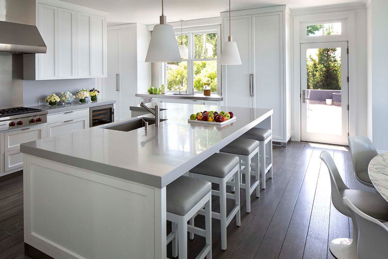 Kitchen Ideas - In this contemporary kitchen, the grey and white color palette keeps the interior bright and open. #KitchenIdeas #KitchenDesign #GreyAndWhiteKitchen