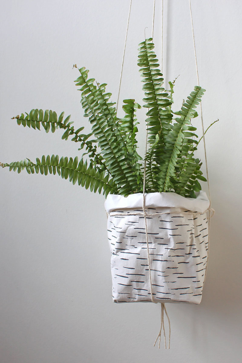 Decor Ideas - Mairita Jonikane of the WarmGreyCompany has designed a collection of modern hanging planters, that look like paper bags and are made from a natural cellulose fibre. #HangingPlanters #Planters #HomeDecor #ModernDecor #Decor Ideas #Plants