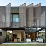 Large Metal Screens Provide Privacy For This New House