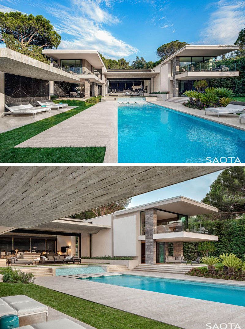 This modern house has two rectilinear wings that wrap around the central courtyard, that leads down to the swimming pool and yard. #SwimmingPool #Landscaping #Architecture #ModernHouse