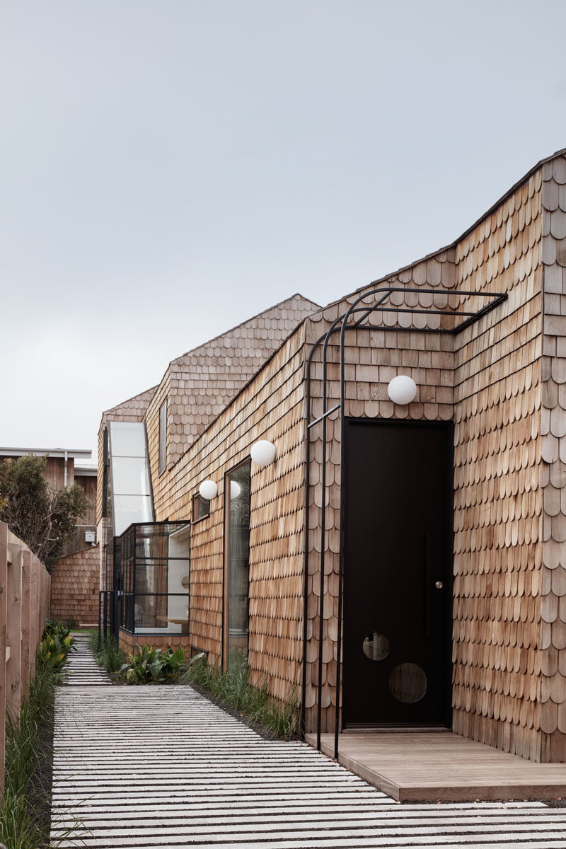 Mani Architecture has designed a modern cottage-like house in Melbourne, Australia, that's covered in wood shingles.  #Shingles #ModernHouse #HouseDesign #Architecture