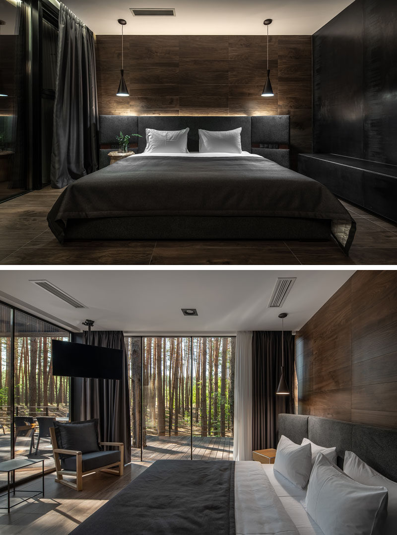 Bedroom Ideas - In this modern bedroom, a wood accent wall becomes the backdrop for the grey bed, while floor to ceiling windows showcase the tree views. #ModernBedroom #BedroomIdeas #WoodAccentWall
