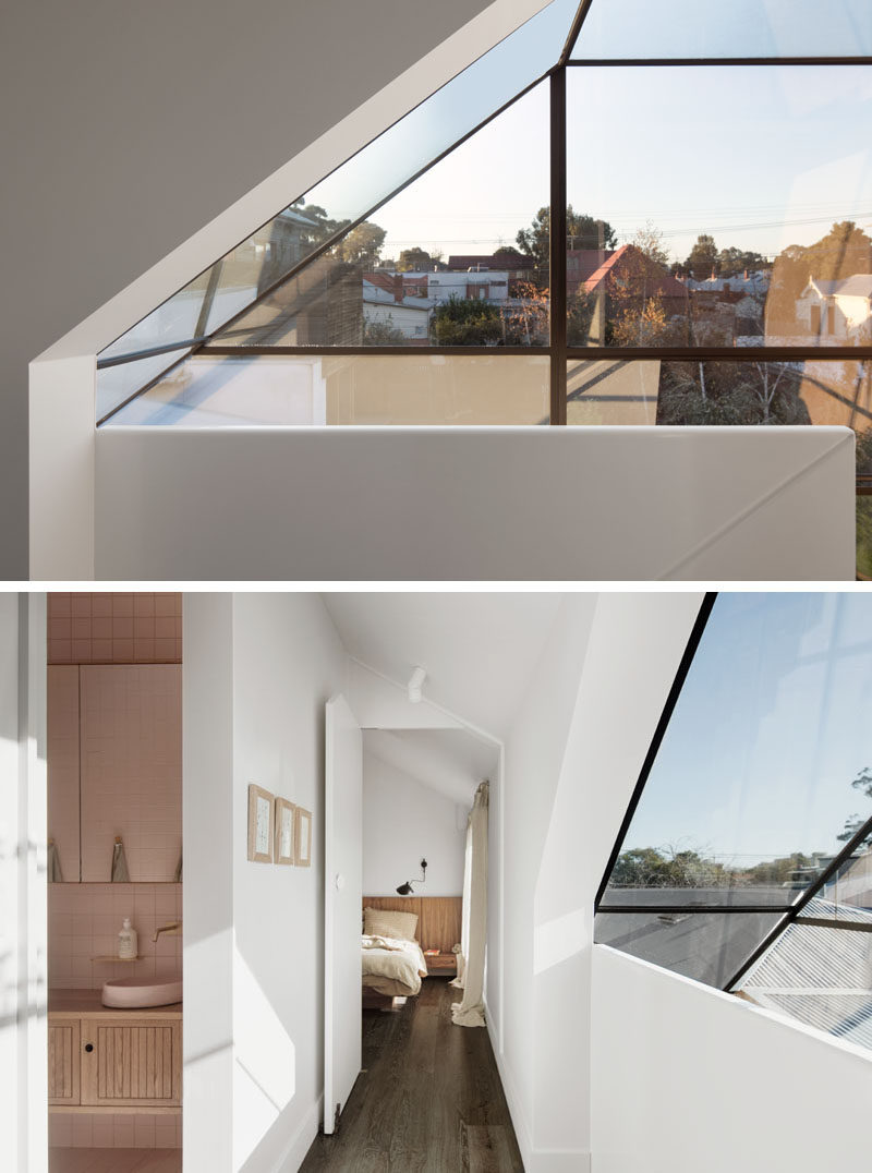 Window Ideas - At the top of the stairs in this modern house, there's windows that form part of the roof, and provide a view of the neighborhood. #WIndows #WindowDesign #WindowIdeas