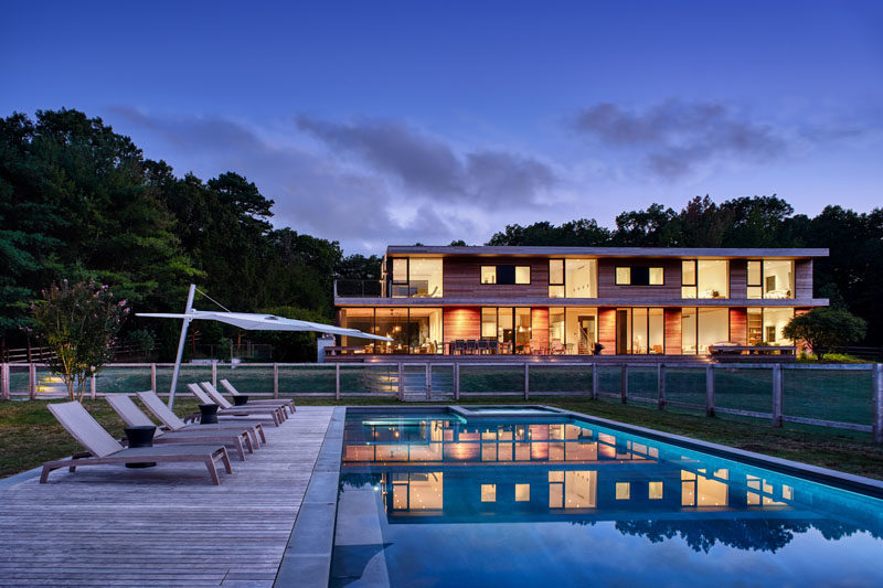 This Hamptons House Opens Up To An Expansive Yard With A Swimming Pool