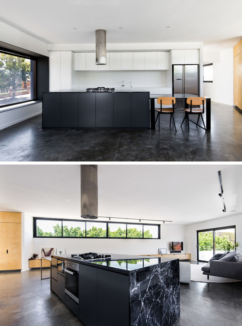Kitchen Ideas - Minimalist black and white cabinetry has been used in the kitchen, while the kitchen table is able to be moved when required. Marble bench tops complement the black powder coated steel and concrete floors. #ModernKitchen #KitchenIdeas #KitchenDesign