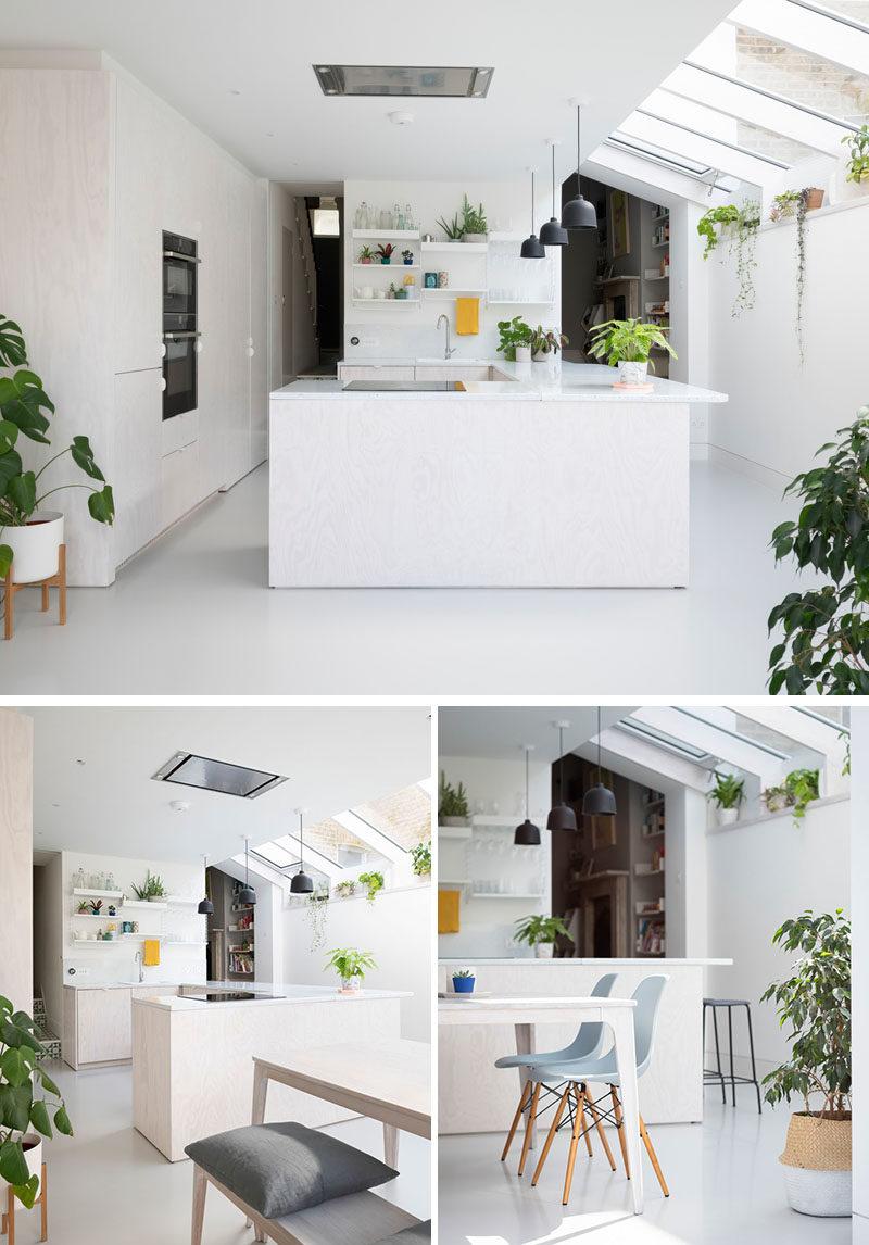 Kitchen Ideas - This modern kitchen has whitewashed Douglas Fir cabinets, an enamel splatterware worktop, and a plant shelf that runs the length of this new extension. #ModernKitchen #WhitewashedWood #PlantShelf
