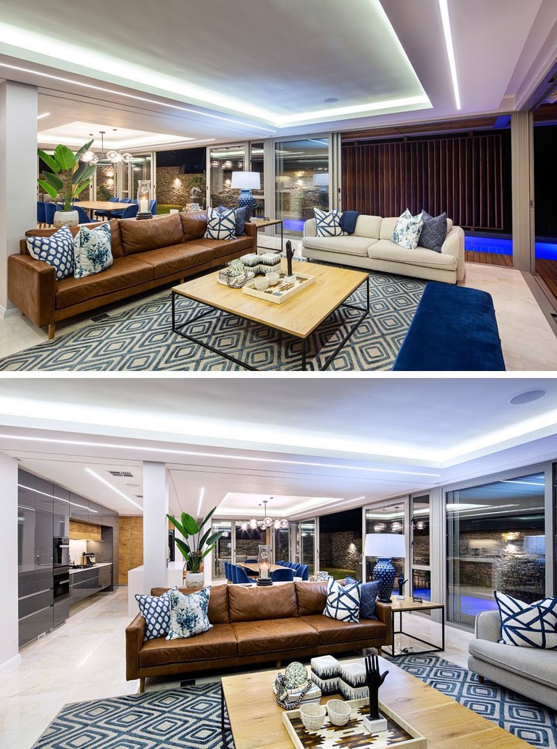 Living Room Ideas - Inside this modern house, glass walls walls connect to the outdoor spaces, while in the living room, recessed ceilings draw attention due to the hidden lighting. #ModernLivingRoom #LivingRoomIdeas #LivingRoomDesign