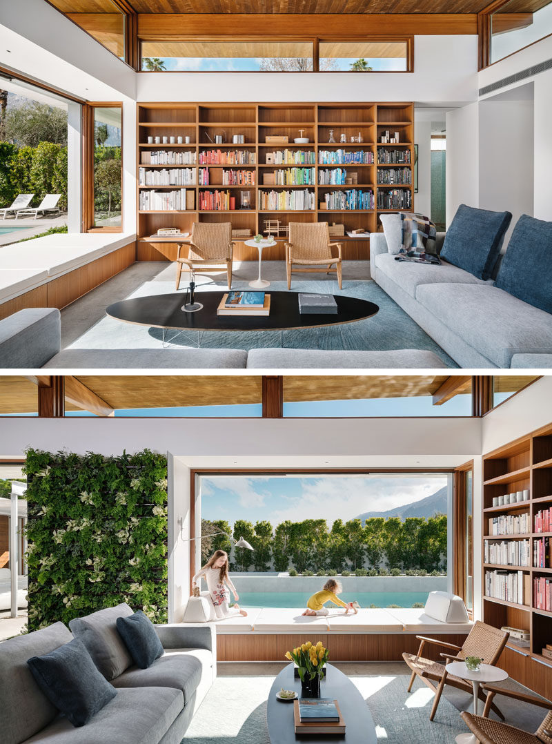 Living Room Ideas - In this modern living room, custom cabinetry lines the wall, while a window seat connects to the outdoor space. #LivingRoomIdeas #ModernLivingRoom #WoodBookshelf #WindowSeat