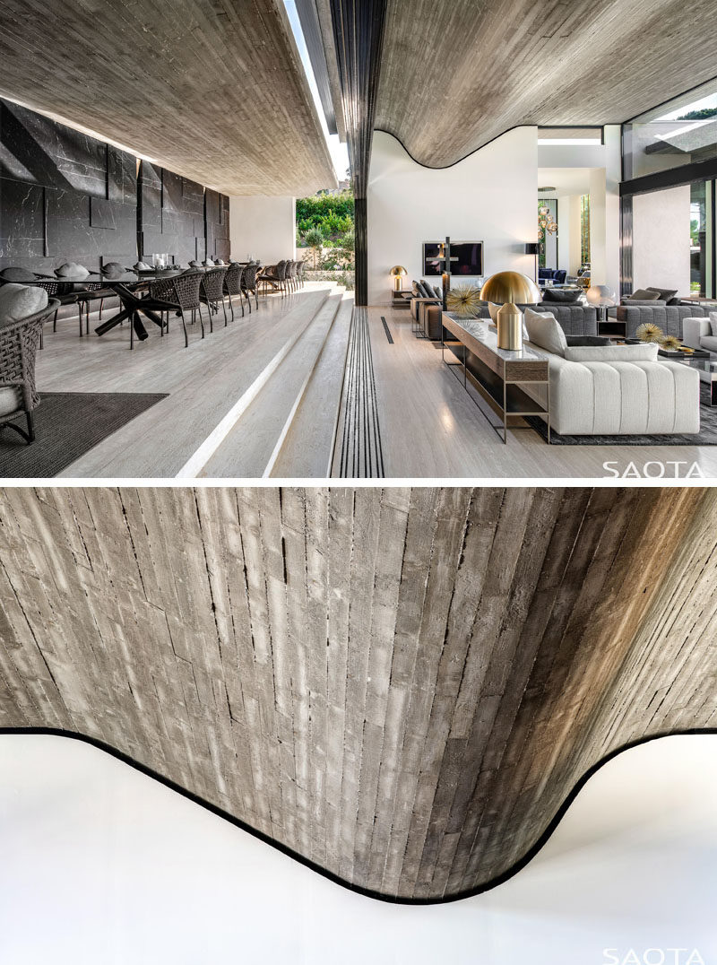 Architecture Ideas - This modern wavy concrete ceiling was created by using raw wood planks that reference the pine trees outside, while the folded shape represents the cascading terraces of the landscape. #Concrete #ConcreteCeiling #Architecture #ModernHouse #HouseDesign