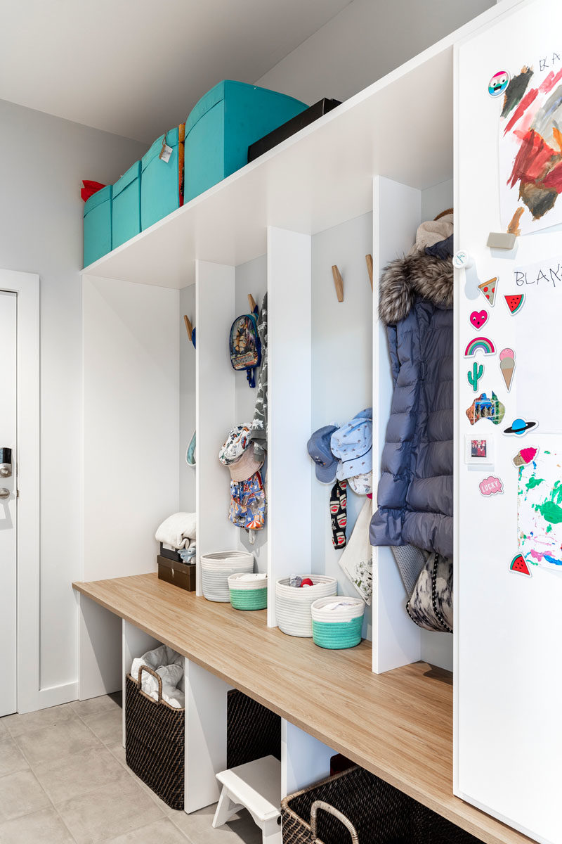 Mudroom Ideas - This mudroom has individual cubbies with hooks to give each child their own space to storage hats, jackets, and shoes. #MudroomIdeas #MudroomDesign