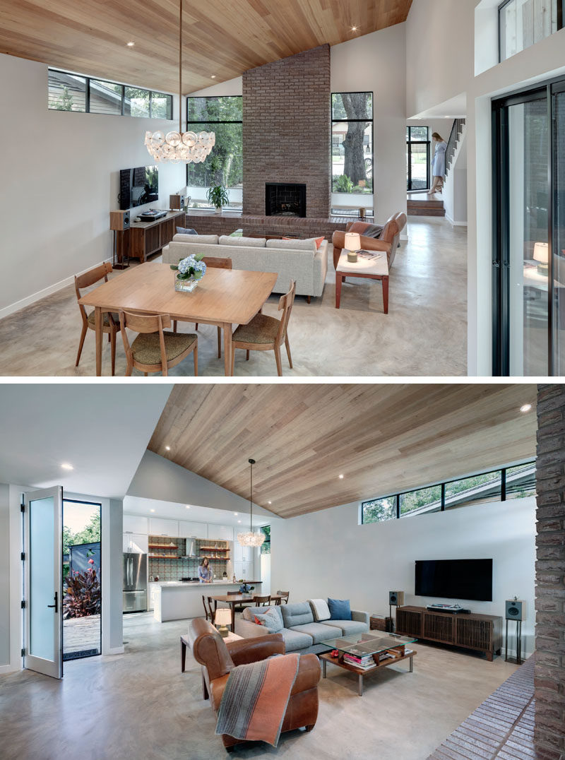 The open plan main floor of this modern house has the living room, dining room, and kitchen sharing the space. #ModernInterior #OpenPlanInterior #WoodCeiling