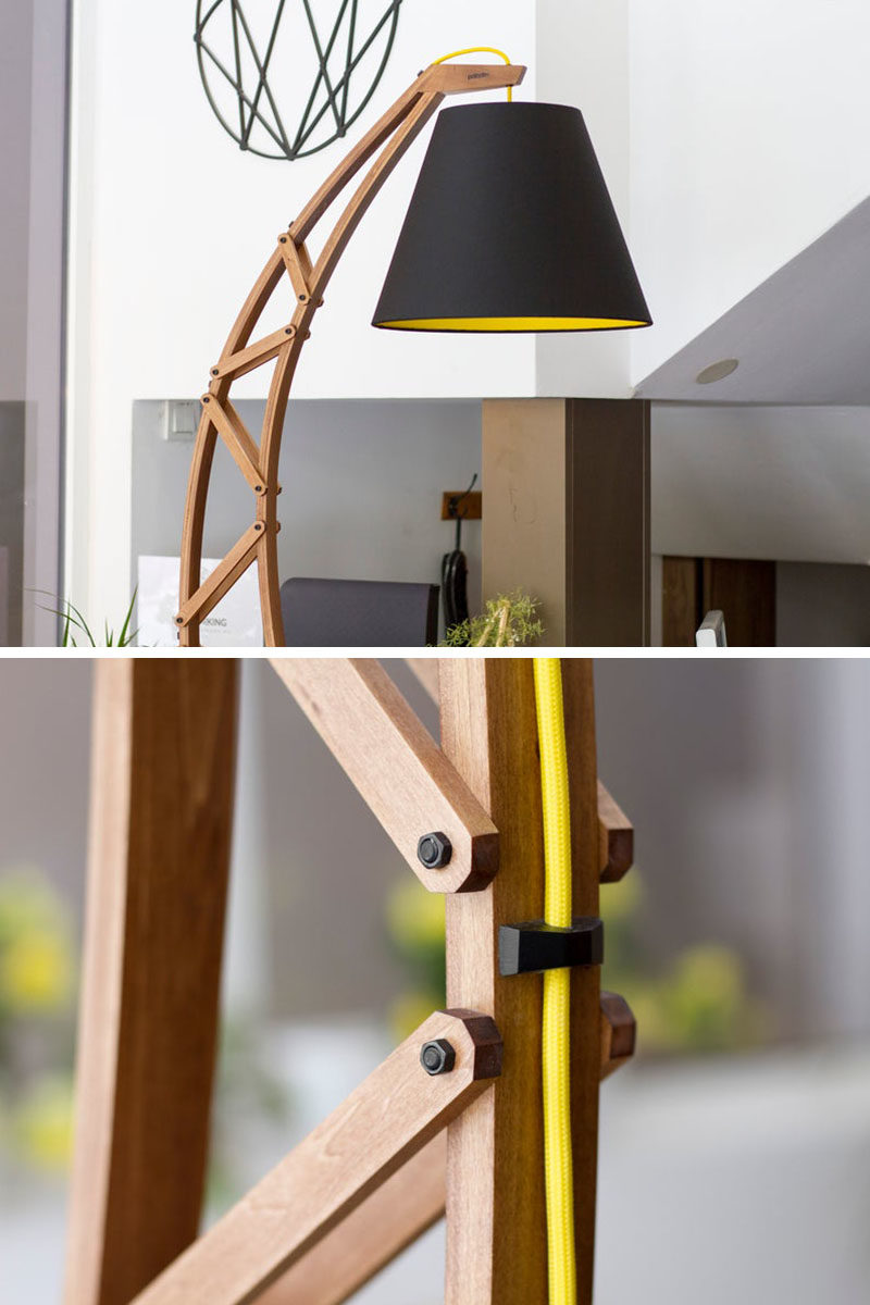 Lighting Ideas - Paladim Design Workshop has created 'ARKA', a modern floor lamp that combines wood with metal accents, a black shade, and a pop of yellow. #ModernFloorLamp #OversizedFloorLamp #OversizedLighting #Design #LightingIdeas #ModernDecor