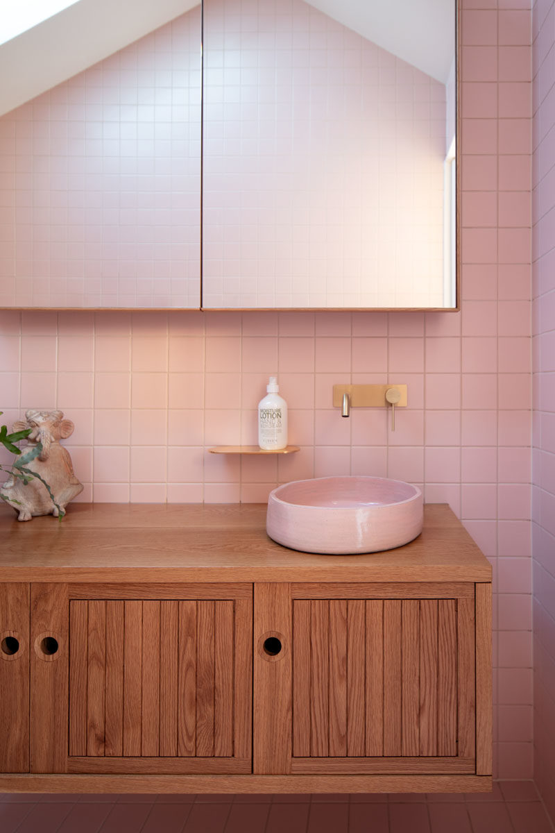 Bathroom Ideas - This modern pink bathroom adds a fun and soft pop of color to the interior. #PinkBathroom #BathroomIdeas #ModernBathroom #BathroomDesign