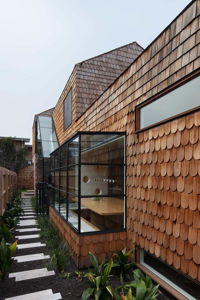 Landscaping Ideas - A small stepping stone path along the side of this modern shingle covered house, leads to a plunge pool, and connects to the front garden. #Path #GardenPath #Landscaping #Shingles #HouseDesign