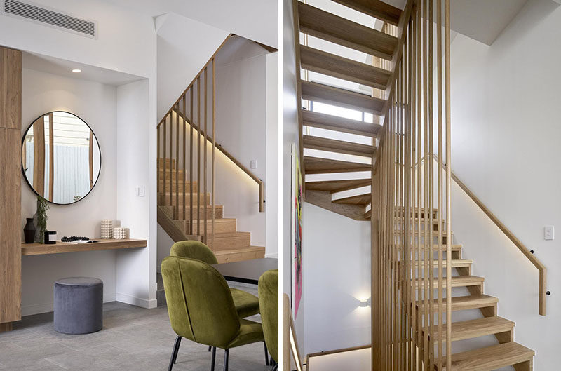Stair Ideas - Hidden lighting built into the handrail of these modern wood stairs, makes it easy to use them at night. #WoodStairs #ModernStairs #StairDesign #Handrail