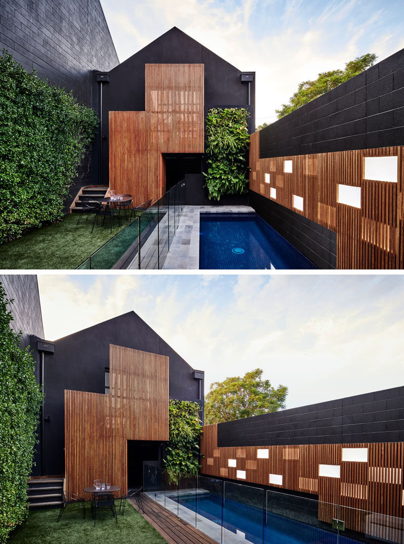 Swimming Pool Ideas - Feature light panels in the accent wall reflect the timber cabinetry within the house, with some of the light panels in the wall exposed, while others are partially hidden behind timber battens, creating a playful element to the space and reflecting on the pool water in the evening. #SwimmingPoolIdeas #PoolIdeas #GardenIdeas #LnadscapingIdeas #ModernPool