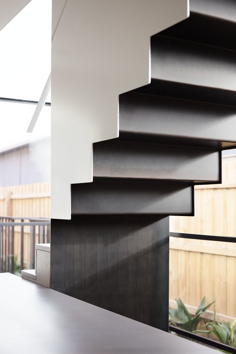 Stair Ideas - This modern staircase runs alongside a wall of windows, helping to fill the interior with plenty of natural light. #Stairs #Windows #ModernStairs #StairIdeas #StairDesign