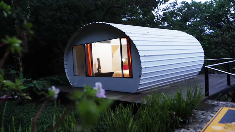 A curved metal tiny house