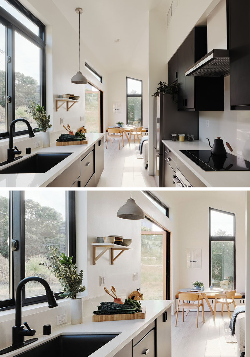 Tiny House Ideas - In this modern tiny house, the kitchen doubles as a hallway to the bedroom and bathroom, while the black cabinets contrast the light walls and white quartz countertops, and complement the black window frames. #TinyHouseKitchen #ModernKitchen #BlackKitchen #SmallKitchen